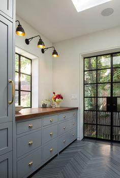 Steel blue cabinets with brass handles