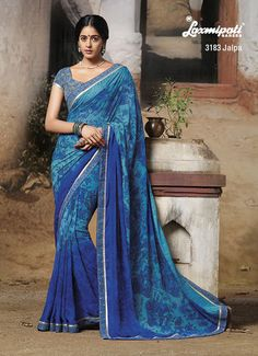 """In order to irreplaceable one must always be different- contrast gray diamond studded printed blouse piece with blue georgette saree."