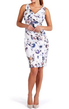 The Adele floral print dress offers a stunning fit with clever pleats and strategic asymmetric draping, making Adele the ultimate in go-to dresses for all your upcoming weddings, parties and occasions. A tailored shift dress with added stretch, the fit is demure yet sexy. This dress looks amazing on all figures shapes, from boyish to busty. In a beautiful and delicate floral print against a textured woven white background, tastefully embellished with bead clusters & silver thread.