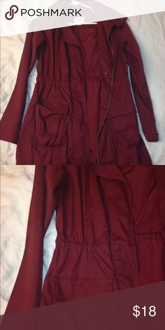 Maroon light trench jacket Lightweight, maroon jacket with two front pockets, zip up, cinched waist, high collar, about mid thigh length Mossimo Supply Co Jackets & Coats Trench Coats