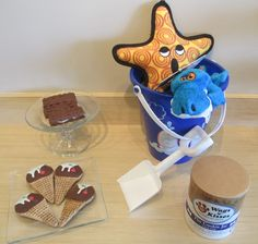 Give your pup a sweet treat to get in the summer spirit for our Ice Cream Social tomorrow! Doggy ice cream sandwiches, ice cream cone cookies, or even one of our summer themed toys are just the thing to get your pooch's tail wagging!