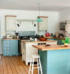 Turquoise and Cream Kitchen.  I like all the wood... top of the cabinets is interesting.  Not sure if I could pull that off with our oak crown or not.