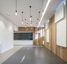 When you only occasionally need a lot of tables, but don't have a lot of space to store furniture, fold-up designs can be the ideal solution. In this case, Moxon Architects created sleek, minimalist white work surfaces for Arts Council England that can be hoisted flat against the wall when not i ...