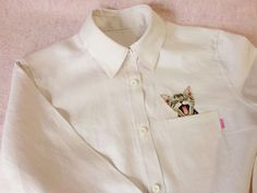 Miauw! Overhemden met geborduurde katten