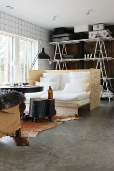 Plywood Sofa by Maliin Stoor I love the couch, and I love love love the wall of tables as shelving!