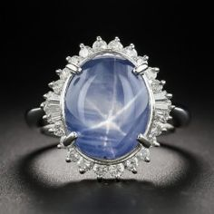 A glowing cornflower-blue star sapphire with a distinct six-legged star (or asterism), weighing carats, radiates from within a bright-white and sparkling diamond halo in this delightful smile-maker, crafted in platinum during the third quarter Baguette Diamond, Halo Diamond, Vintage Rings, Vintage Jewelry, Blue Star Sapphire, Antique Diamond Rings, Diamond Glitter, Sapphire Jewelry, Love Ring