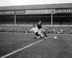 Aston Villa 0 Tottenham 2 in Feb 1961 at Villa Park. Peter Barker tackles Peter McParland in the FA Cup 5th Round.