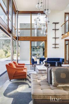 Mid-century modern living room #comfort #living #orange #design