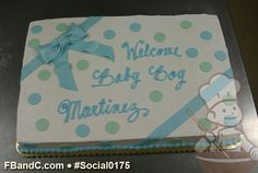 Social0175   Baby Shower Cake   Buttercream cake with present bow and light blue and green fondant polka dots.