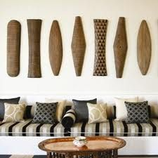 A great display of African shields! // MIXfurniture has plenty in different shapes and patterns for you to make your own!