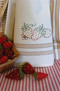 A trio of plump, ripe strawberries are embroidered on a Gold Stripe Tea Towel.