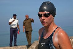 Australian swimmer Chloe McCardel prepares to begin her swim to Florida from the waters off Havana, Cuba, Wednesday, June 12, 2013. McCardel says she expects to spend about 60 hours in the sea before reaching the Florida Keys, a little more than 100 miles to the northeast. McCardel jumped into the water at Havana's Hemingway Marina on Wednesday morning, accompanied by kayakers and a support boat. (AP Photo/Ramon Espinosa)