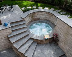 beautifully simple hot tub design with stone stairs