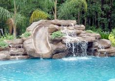 """Add slide to one corner of pool, with stone feature, and waterfall that creates a little """"hideout"""" underneath. Pool Garden, Backyard Pool Landscaping, Swimming Pools Backyard, Swimming Pool Designs, Landscaping Ideas, Waterfall Landscaping, Swimming Pool Slides, Backyard Waterfalls, Garden Ponds"""
