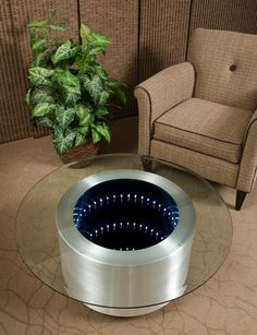 Artist Doug Durkee - contemporary aluminum coffe table - infinity mirrors - wishing well   SO Awesome!