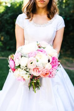 """My wedding bouquet had ranunculus, English garden rose, Anemone, and Hypericum berries. The flowers were different shades of pink with some creamy white flowers mixed in too.""  (photo by Mary Claire Photography)"