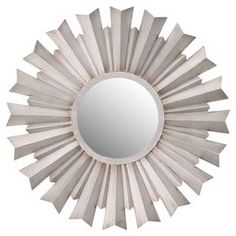 "Weathered wall mirror with a geometric design.       Product:  Wall mirror    Construction Material:  Metal, wood and mirrored glass    Color:  Bone   Dimensions: 31.5"" Diameter      Cleaning and Care:  Wipe clean with damp cloth"