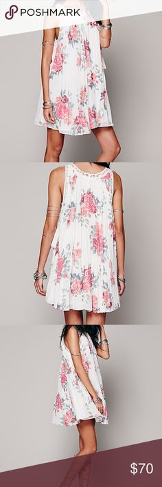 Free People Pleated Tent Dress Floral printed pleated tent dress in a sheer chiffon; sleeveless, with lace insets and trim and flirty side ties. Lined. Free People Dresses Midi