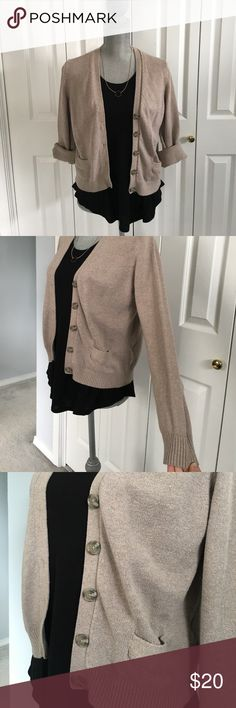 Tan cardigan Beautiful tan cardigan. Two front pockets and accent buttons make this cardigan a true minimalist statement piece. I like to roll up the sleeves for added interest. EUC! Lands' End Sweaters Cardigans