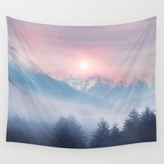 A rising run over a frosty forest with the crisp mountains in the background. A pink sky over the blue mountains is the perfect setting and looks great on this Tapestry.