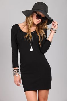 Simple black dress -- would look even better belted