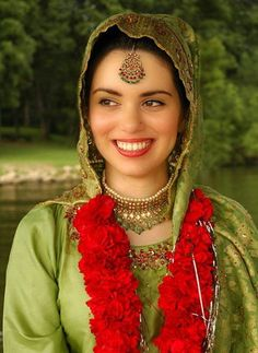 #A beautiful Pakistani bride in lovely red, gold, and celery hues. #bride #wedding #Pakistan #traditional #costume #clothing #folk #dress #travel #woman  #We cover the world over 220 countries, 26 languages and 120 currencies hotel and flight deals.guarantee the best price multicityworldtravel.com
