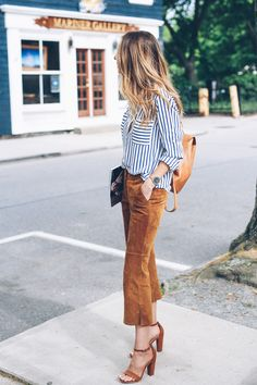 Jess Kirby styles suede pants and a stripe blouse for chic work week style on Prosecco & Plaid