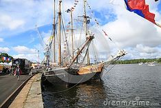 Two sailing ships stand side by side near the pier. Time of the regatta THE TALL SHIPS RASES Kotka 2017. Kotka, Finland