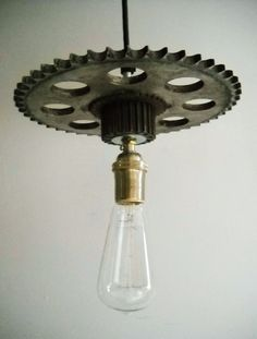 One Industrial Pendant Light Hanging Vintage Steampunk Metal Used Automobile Gears with Edison Marconi Filament Bulb. This hanging pendant light is made with old vintage metal timing gears taken from automobiles. There are two gears which have been upcycled into a industrial style hanging pendant light with an Edison bulb filament bulb and 5 feet of heavy duty pendant lamp industrial wiring, which should be more than enough for most uses. (Additional length available on request). This light…