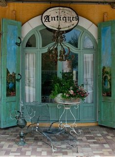 Turquoise Antique Shop......but I would decorate my outside space like this! Beautiful!