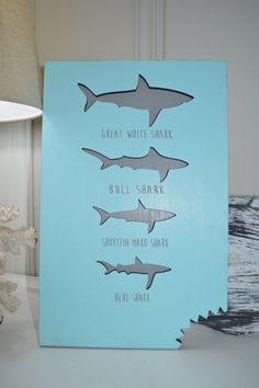 If you have a love for the ocean then youre going to love our BLUE SHARK BITE sign. Handmade and designed just for you. Perfect decoration for home, kitchen, kids room, yard or workplace. Makes a great gift for all those beach lovers too.  ***This sign has the shark silhouette cut out of four different sharks with shark names engraved under each shark shape. Shark # 1: Great White Shark Shark # 2: Bull Shark Shark # 3 Shortfin Mako Shark Shark # 4: Blue Shark ***The bottom corner has a SHARK...