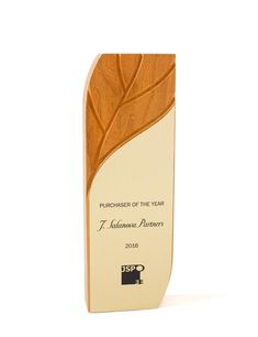 An elegant award featuring a carved leaf, our laser engraved Aspire Award highlights the warmth of FSC®-certified cherry.