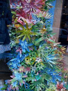 An Anthropologie window display.  Flowers made from plastic pop bottles.....
