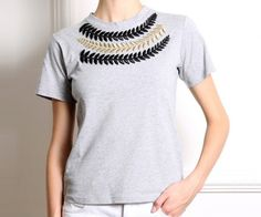 Gray shirt with embroidery | #ASLIFILINTA is trend. An elegant design of the designer born and raised in Turkey, but based in New York, Asli Filinta. Like all his designs, this gray shirt with embroidery is a basic garment but reinvented for her to take on special occasions or everyday hassle. #woman #mens #home #fashion #style