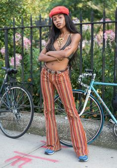 """Dylan,22""""I am wearing my favorite vintage bell bottoms from Berlin, a swim top I wear as a bralette, New Balances, a Kangol, and a dragon medallion. My friends, family, history, culture inspire my style.""""Aug26,2017 ∙ Afropunk Festival"""