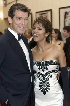LONDON, NOVEMBER 18: (FILE PHOTO) Pierce Brosnan and Halle Berry arrives for World Premiere of the James Bond film 'Die Another Day' attended by Britain's Queen Elizabeth II, at the Royal Albert Hall on November 18, 2002 in London, England. (Photo by Anwar Hussein/Getty Images) via @AOL_Lifestyle Read more: http://www.aol.com/article/2016/07/06/pierce-brosnan-model-son-dylan/21425214/?a_dgi=aolshare_pinterest#fullscreen