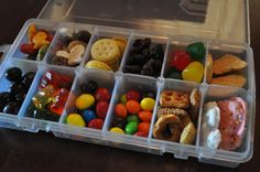 """Travel tip for road trips with your little ones! Fill tackle boxes with an assortment of bite-sized snacks and label with each kid's name, then throw it in a cooler and surprise them when they get restless in the car! A fun way to to satisfy their """"are we there yet"""" pleas."""