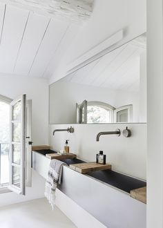 Bathroom with wooden shelves over the large sink