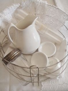 . . . Cabin & Cottage : Simple White Things a wire canning basket as a pretty basket