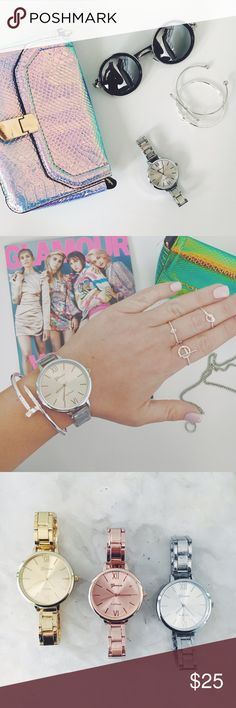 New! Silver Stainless Steel Chain Link Watch NWT Boutique Item. Super cute addition to any #ootd! This quartz watch features a classic design and a clasp to open and close. It is available in silver, rose gold, and gold. Band Width: 12 mm, Dial Diameter: 40 mm, Case Thickness: 7 mm, Material: Stainless Steel (tarnish resistant), Length: Will fit a wrist up to 21 cm. Please note: My wrist is 15cm & I needed to get links removed for it to fit tighter.Great for Valentine's Day Geneva Platinum…