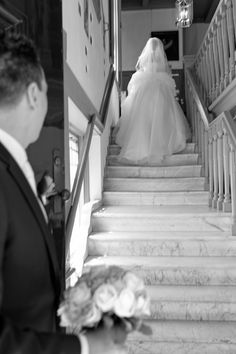 Journalistieke bruidsfotografie in Elburg - de Veluwe - bruidspaar - bruid en bruidegom - trap - Wedding Photograpy - Netherlands - Dronten - Flevoland - Overijssel - bride - groom - stairs