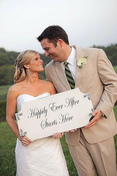 Posting this in Wedding Ideas instead of poses cause I love the little sign they are holding!