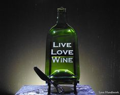 You are looking at slumped melted bottle cheese board wall hanging with a Spread the Love labelled spreader knife The bottle has Live Love Wine etched on it These pieces Wine And Liquor, Liquor Bottles, Glass Bottles, Vodka Bottle, Slumped Glass, Fused Glass, Bottle Slumping, Glass Beer Mugs, Recycled Bottles