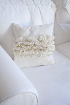 ruffle pillow..finally have some of these for my livingroom!