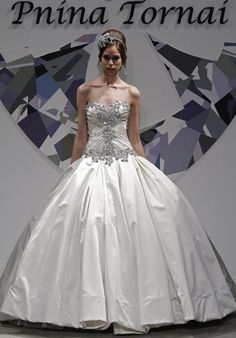 Gown features large stone embellished bodice.