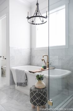 Master Bathroom Reveal | Start at Home Decor | Free standing tub | Marble bathroom | Bathroom Fixtures, Bathrooms, Toothpaste Holder, Freestanding Tub Filler, Quarter Sawn White Oak, Floating Vanity, Hanging Light Fixtures, Bathroom Stuff