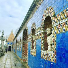 At the Palace of Fronteira busts of the Kings of Portugal line a tile covered wall over looking the topiary garden #lisboa #portugal #portuguesekings #bluetiles #fronteirapalace