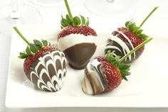 Driscoll's Marble Chocolate Covered Strawberries www.driscolls.com-so pretty- drag toothpick down stripes to make marbelizing. I always add 1/2 to 1tablespoon of Crisco to chocolate when melting