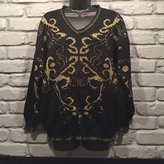 SALE! Vintage Black and Gold Sweater Size medium. Vintage sweater. Can also fit a large or for an oversized small. Great condition.  Beautiful print. Very fun and funky!                                NO TRADES/ PAYPAL ✔DON'T ASK FOR MY LOWEST PRICE, PLEASE USE OFFER BUTTON ❤️BUNDLE TO SAVE! ⏳I ONLY HOLD ITEMS FOR 24 HOURS Ellen D. Sweaters V-Necks