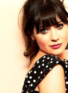 Zooey Deschanel--love her! This makes me want to trim my bangs again :)